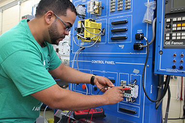Advanced Manufacturing student at control panel