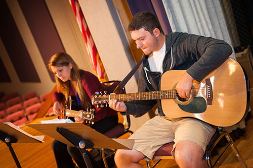 Two Student Playing Guitar